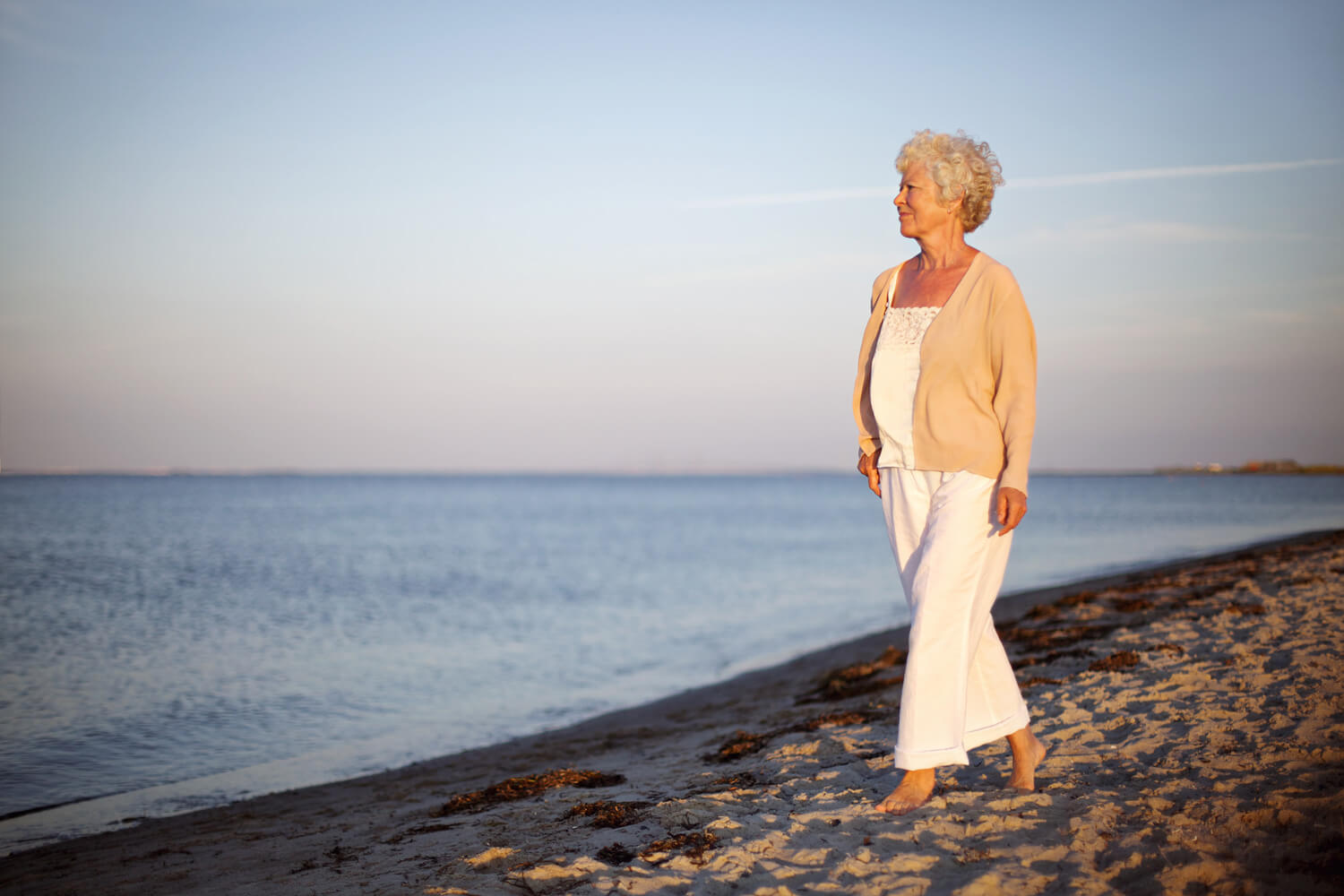 senior-woman-walking-beach